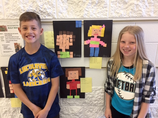 Students in Liz Utz's third grade class finalized their fraction unit with making fraction people to resemble themselves. Each student made their portrait and then had to find the fraction of each color square used. Students enjoyed finding how many total squares they used along with the fraction of each color.  (Photo submitted.)