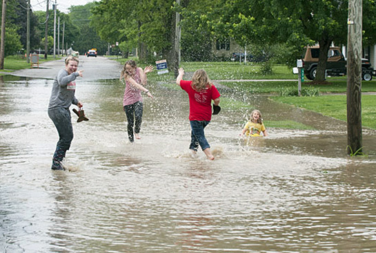 Flood image-kids playing on Burt St. 5-25-17