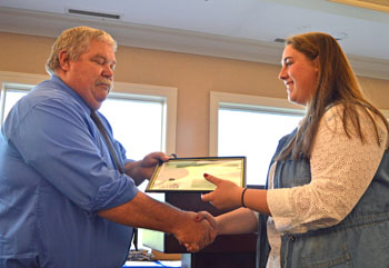 Lincolnview senior Macala Ashbaugh receives the Farm Focus Scholarship during Monday's awards night at Willow Bend Country Club. More than $40,000 in scholarships was presented to a group of 33 seniors. (Lincolnview photos)