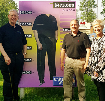 Van Wert native and philanthropist Scott Niswonger (left) poses beside a headless version of himself with United Way 2017 Campaign Chair Mark Verville, and United Way Executive Director Vicki Smith after the campaign mets its $475,000 goal. (United Way photo)