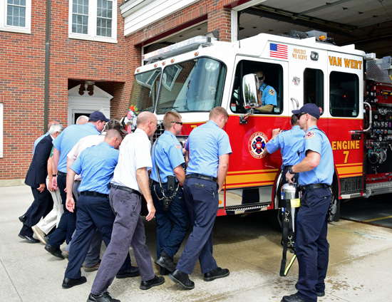Van Wert firefighters and the city officials participate in pushing-in and wetdown ceremonies for the department's new Smeal fire engine on Thursday. Dave Mosier/Van Wert independent