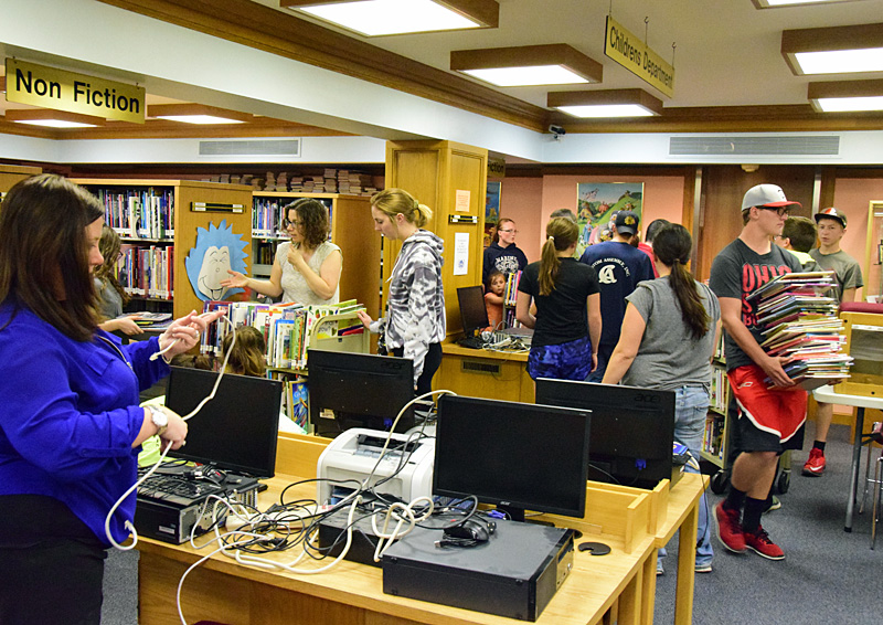 Things were bustling Friday afternoon in Brumback Library's Children's Department as hordes of volunteers showed up to help move books, computers, and other equipment upstairs. Dave Mosier/Van Wert independent