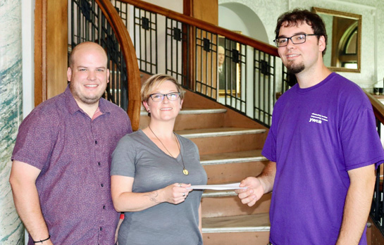 Craig Alex (left) and Carrie Paquette present Jordan Dettrow with a check for $1,024.37 for the YWCA's Summer Food Program. (photo submitted)